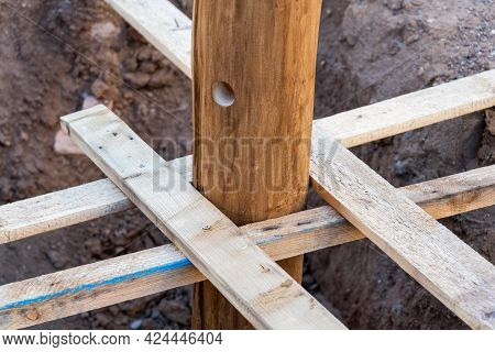 A Wooden Log Fixed With Struts In A Pit, Before Pouring Concrete