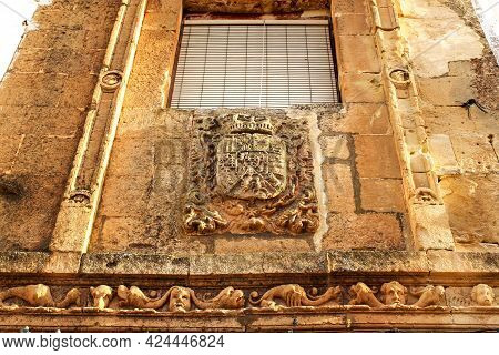 Old Stone Facade Made Of Carved Stone With Coat Of Arms In Alcaraz, Castile-la Mancha, Spain