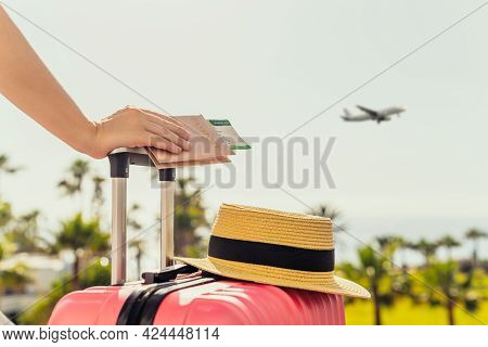 Woman With Pink Suitcase And Passport With Boarding Pass Standing On Passengers Ladder Of Airplane O