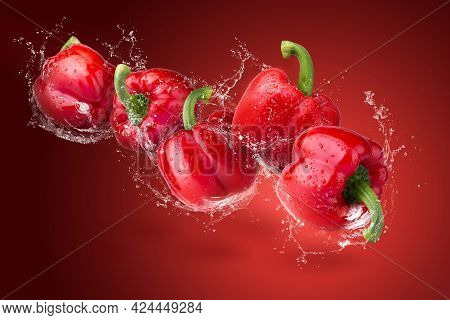 Water Droplets On Red Bell Pepper Isolated On A White Background