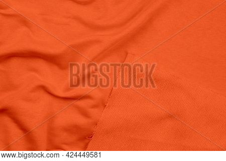Background From Orange Monochrome Cotton Fabric. Close Up Texture