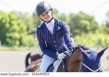 Happy Teenage Rider Girl After Her Dressage Test