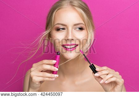 Blonde Model Girl Holding Pink Lipstick Brush Over Bright Magenta Background. Summer Beauty Woman Fa