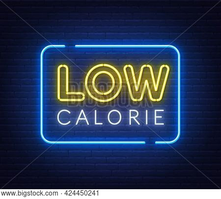 Low Calorie Neon Sign On Brick Wall Background.