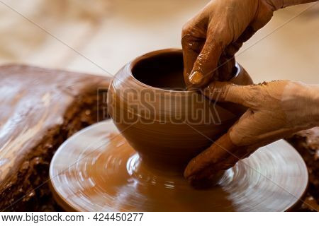 Elderly Hands Of A Potter, Creating An Earthen Jar On The Circle. Old Woman Makes Hand Made Ceramics