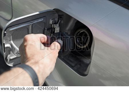 A Man Opens A Gas Tank In A Car For Refueling With Gasoline.