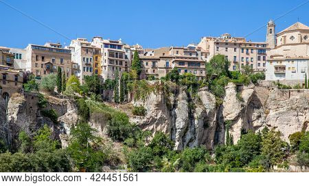 Houses on the very brink of cliff. Panoramic view of the old town of Cuenca, Castilla-La Mancha, Spain. Landscape - cityscape