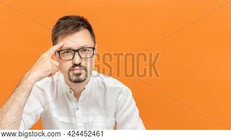 Handsome Caucasian Man Wearing White Shirt Over Isolated Background. The Young Bearded Man Pointing