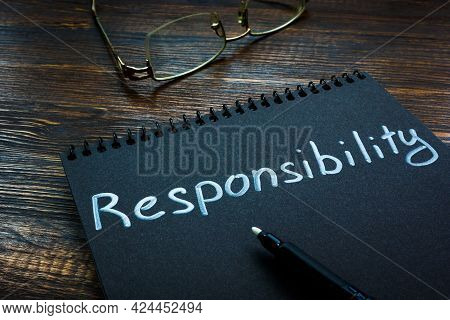Responsibility Word Handwritten On The Black Page.