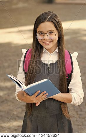 A Knowledge Library. Happy Kid Hold School Book. Library Reader Outdoors. School Library. Cute Bookw
