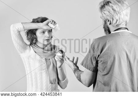 Doctor Advertising Product. Patient And Doctor Hold Pills. Woman With Runny Nose At Nurse Consultati