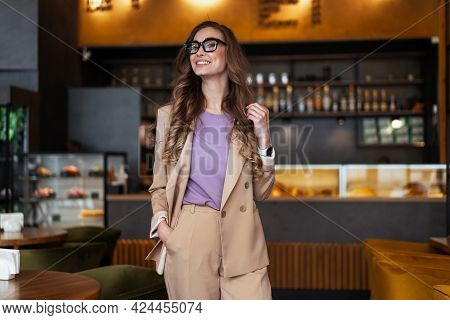 Business Woman Restaurant Owner Dressed Elegant Pantsuit Standing In Restaurant With Bar Counter Bac