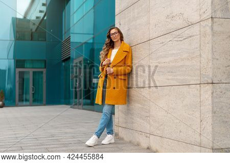 Business Woman Dressed Yellow Coat Standing Outdoors Corporative Building Background Caucasian Femal