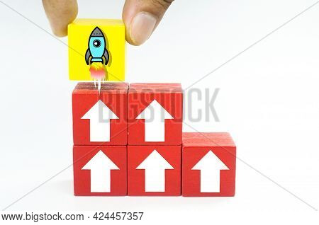 Colored Cubes With Up Arrow And Rocket Start. The Concepts Of Startups, Income And Success