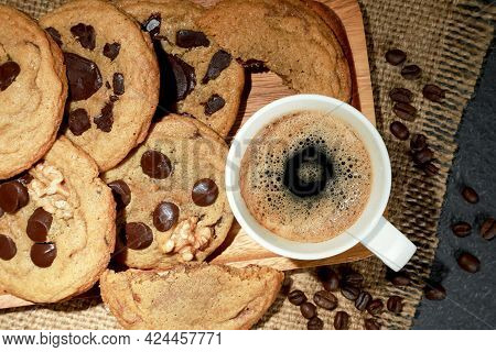 Top View Of Hot Fresh Coffee In A White Cup With Foam And With Homemade Less Sugar Chocolate Cookies