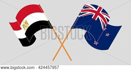 Crossed And Waving Flags Of Egypt And New Zealand