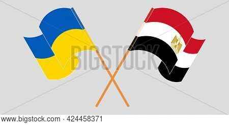 Crossed And Waving Flags Of Egypt And The Ukraine