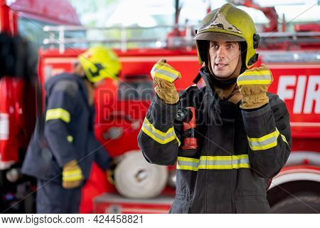 Fireman Or Firefighter Stand And Show Some Action Look Like He Report The Situation Of Some Events F