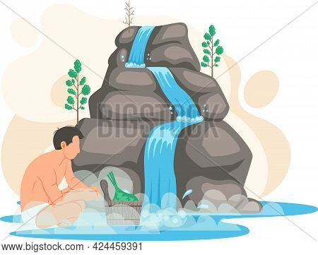 Man Sits In Water In Lake Next To Rock And Waterfall. Clean Nature Concept, Tropical River And Beaut