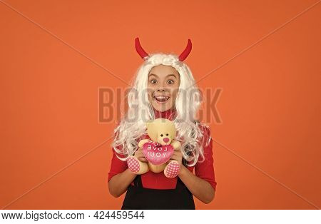 Thank You. Smiling Child In Devil Horns With Teddy Bear Toy. Kid Has White Hair Wig. Childhood Happi