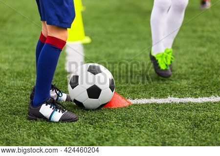 Soccer Player With White And Black Football Ball In A Corner. Young Athlete Kicking Ball On Grass Fi
