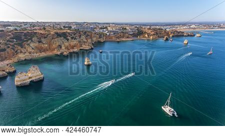 Aerial View Of The Beautiful Paradise Beaches Of Camilo And Dona Anna, Lagos Area. Tourist Boats And