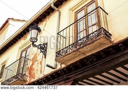 Old Majestic Facade And Streetlight In A Small Village Of Castilla La Mancha Community, Spain. Alcar