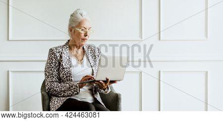 Empowering senior CEO using a laptop