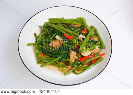 Stir Fried Morning Glory On A White Plate On White Background