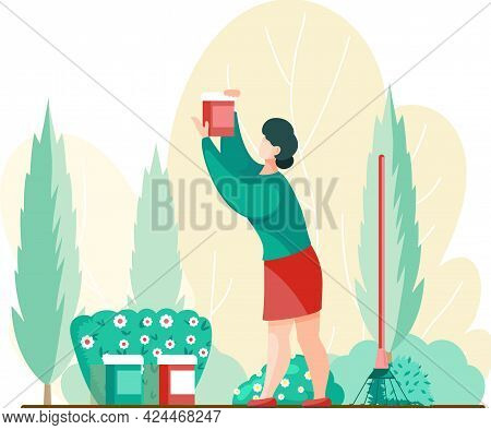 Woman Gardener And Farmer Works In Garden, Takes Care Of Yard. Female Gardening, Agricultural Worker