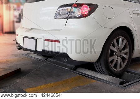 Vehicle While Roller Brake Tester, White Color Car. Automotive Safety Concept.