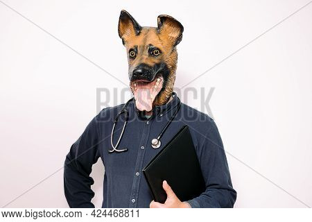 Person With A Dog Mask And Stethoscope With A Folder Under His Arm On White Background, Concept Of A