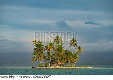 Tiny Tropical, Uninhabited Island With Coconut Palm Trees And White Sand Beach. Vacation And Travel