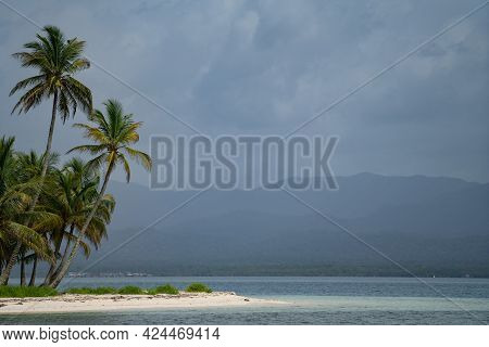 Tiny Tropical, Uninhabited Island With Palm Trees And White Sand Beach In Cloudy Weather With Copy S