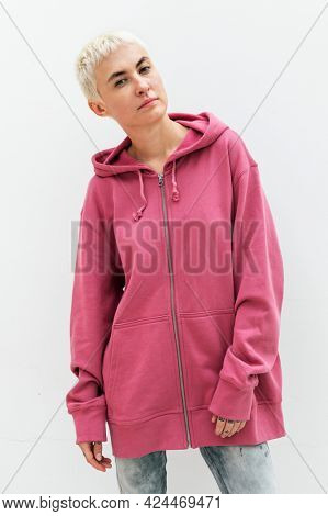 Cool woman in a pink hoodie