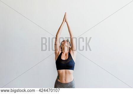 Sportive woman doing a Vriksasana pose