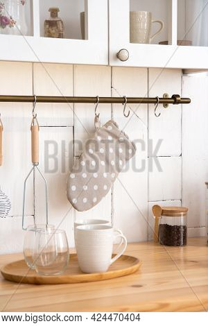 Kitchen Utensils On The Wall Potholder And Whisk