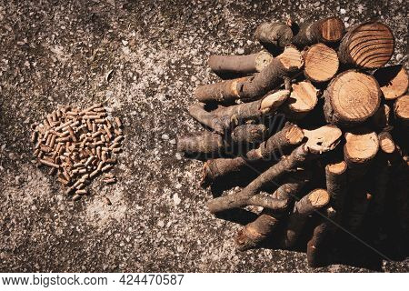Pellet Granules As A Renewable Biofuel For Heating Houses, Pellets In Comparison With Wood Logs Prep