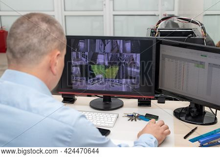 Cctv Security System Operator Monitoring Video Camera In Security Room. Surveillance, Modern Technol