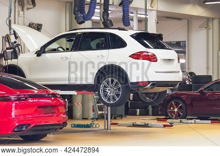 Cars Raised On Car Lift In Auto Service, Open Hood. Machines For Maintenance, Repair, Replacement Of