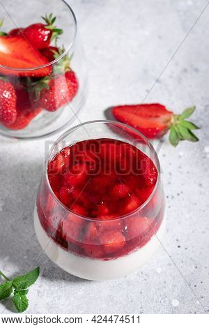Vegan Panna Cotta With Strawberries And Coconut Milk On Gray Background. Healthy Vegan Dessert Conce