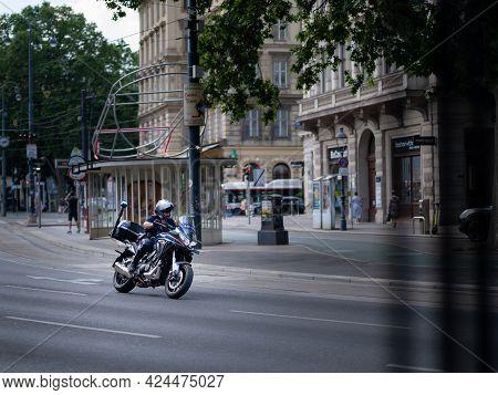 Vienna, Austria - June 19, 2021: Policeman With Motorcycle On Wiener Ringstrasse During Vienna Pride