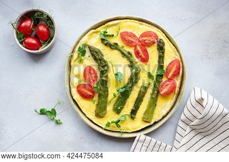 Italian Frittata With Asparagus, Tomatoes And Green Pea Microgreens In Ceramic Plate. Balanced And T
