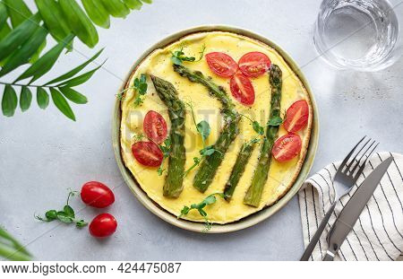 Italian Frittata With Asparagus, Tomatoes And Green Pea Microgreens On Gray Table. Healthy Homemade
