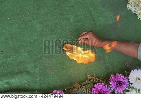 Holy Fire. Hindu Priest Worshipping Idol Of God Jagannath, Balaram And Suvodra With Holy Light. Rath