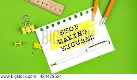 Text Stop Making Excuses Sign Showing On The Green Background With Office Tools