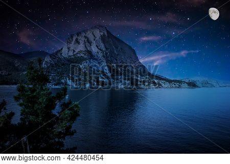 Moonlit Starry Night Over The Bay. Mount Sokol (falcon). Bay On The Black Sea In Crimea, Russia, Nov