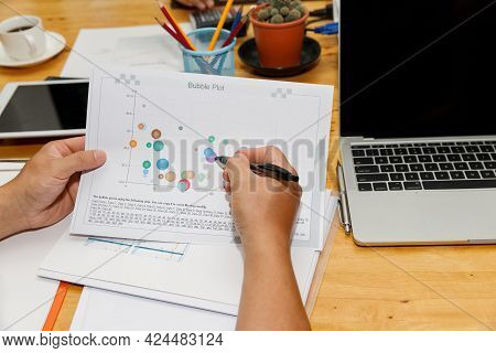 Financial Businessman Accounting Analyzing Charts In Home Office. Investment And Saving Concept.