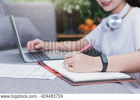 Young Student Watching Lesson Online And Studying From Home. She Using Laptop And Learning Online.
