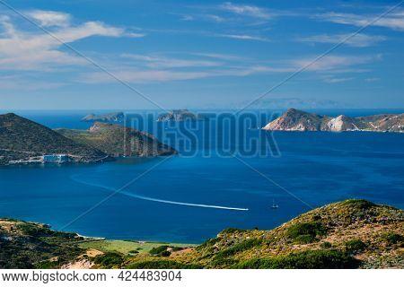 Scenic view of greek scenery - Aegean sea near Milos island with speeding speed boat catamaran ferry vessel on summer day in Greece